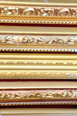 tibetan house: Gold painted wooden frames for paintings for sale in store in the Barkhor areastreet along the Koraclockwise circumambulation circuit around the 642 AD.founded25000 m2 JokhangHouse of Buddha temple. LhasaTibet.