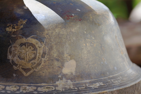 shadowy: Engraved metallic bowl for the monks to collect food offerings