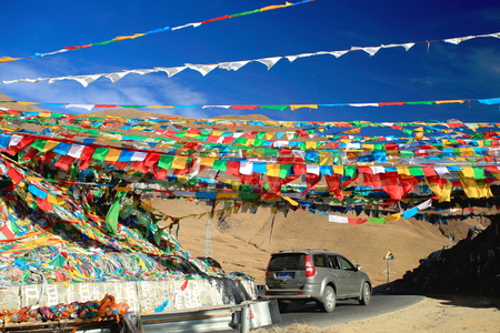 orison: NACHAN LA TIBET CHINA  OCTOBER 21: Buddhist prayer flags under blue sky wave in the wind in the Nachan Lapass at 4500 ms.high over the KyichuLhasa river valley to the NE.from Lhasa Lhasa pref.Tibet A.R.China.