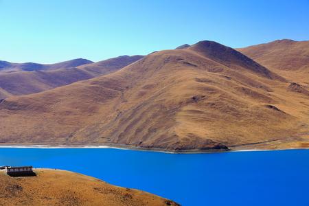 The 638 km2130 km.EW70 km.NS wide250 long bank4441 ms.highturquoise colored Yamdrok TsoUpper Pasture lake from Kamba Lapass. Lhoka or Shannan pref.Tibet. Imagens