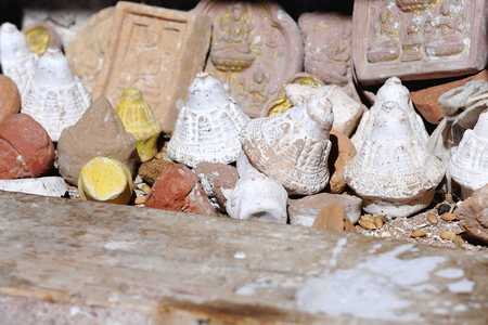 orison: Small buddhist terracotta figurines and relief tablets laid on the ground beside Lhakhang Pukcave. Here Lhalung Pelgyi Dorje is said to have meditated for 22 years from AD.842 on. Drak Yerpa monasterycomplex of more than 80 meditation caves. Lhasa pref.Ti Stock Photo