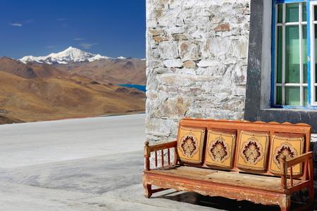 Armchair overlooking the 638 km2130 km.EW70 km.NS250 long bank4441 ms.alt.turquoise colored Yamdrok TsoUpper Pasture lake and mt.Nojin Kangsang at 7206 ms. Kamba Lapass. LhokaShannan pref.Tibet.