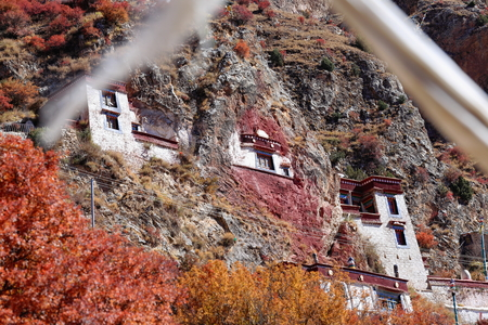 orison: Central buildings of the Drak Yerpa monastery perched on the southwards facing slope of the mountaincomplex of more than 80 meditation caves. Lhasa pref.Tibet A.R.China. Stock Photo