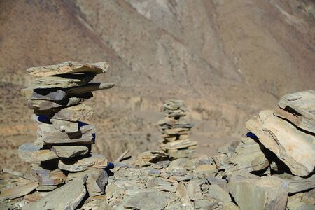 spaciousness: Some cairnsstacked stones seemingly of slate half way up to the 4793 ms.high Kamba Lapass on the Southern Friendship Highway. LhokaShannan pref.Tibet.