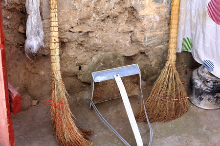 orison: Artisanal traditional hand made brooms and metallic dustpan in a cavecell of the 4885 ms.alt.Drak Yerpa monasterycomplex of  than 80 buddhist meditation caves. Lhasa pref.Tibet.
