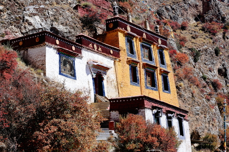 orison: Main gropu of buildings of the Drak Yerpa monastery perched on the southwards facing slope of the mountaincomplex of more than 80 meditation caves. Lhasa pref.Tibet A.R.China.
