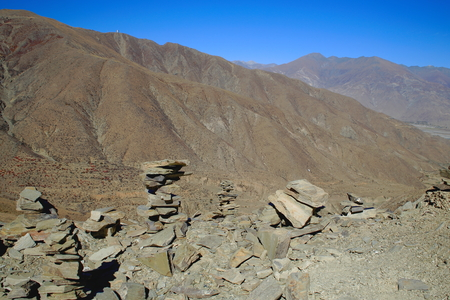 seemingly: Some cairns-stacked stones seemingly of slate half way up to the 4793 ms.high Kamba La-pass on the Southern Friendship Highway. Lhoka or Shannan pref.-Tibet.