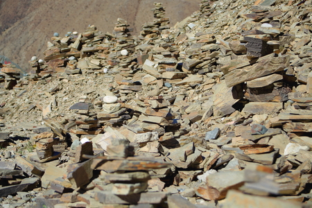 spaciousness: Some cairnsstacked stones seemingly of slate half way up to the 4793 ms.high Kamba Lapass on the Southern Friendship Highway. Lhoka or Shannan pref.Tibet. Stock Photo