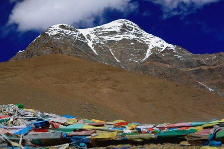 falltime: The 6110 ms.high mount Mungyu Zari seen towards the South from the 5036 ms.high KaroLa mountain pass in the Lhagoi Kangri range of the Himalayas. Lhoka or Shannan pref.Tibet.