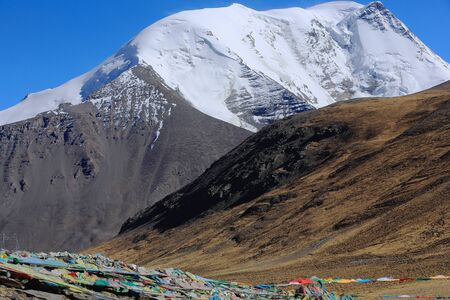 falltime: The 6674 ms.high mount Kalurong or Kaluxung seen towards the South from the 5036 ms.high Karo Lamountain pass in the Lhagoi Kangri range of the Himalayas. Lhoka or Shannan pref.Tibet.