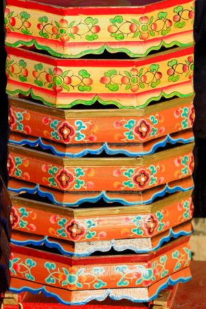 lacquerware: Traditional tibetan style wooden trays stacked on the street at the entry to a local carpenter.s workshop in the lower ara of town. Gyantse city and county-Shigatse pref.-Tibet.