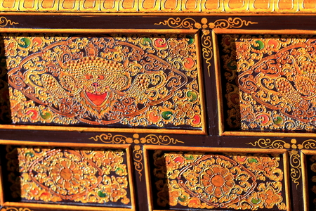 lacquerware: Profusely decorated lacquered wooden ark in a workshop of the 3840 ms.high Shigatse city-county and prefecture at the Yarlung Tsangpo and Nyang Chu rivers confluence. Tibet-China. Editorial