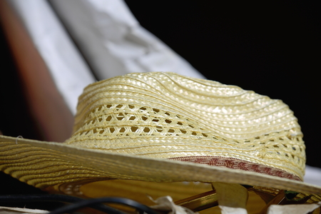 fretwork: Fretwork hat made of raffia and with brown fabric band for sale in a shop in the 3840 ms.high Shigatse city-county and prefecture at the Yarlung Tsangpo and Nyang Chu rivers confluence. Tibet-China.