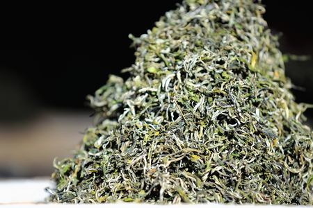 raw tea: Heap of raw tea leaves on the outside of a street market in the 3840 ms.high Shigatse city-county and prefecture in the Yarlung Tsangpo and Nyang Chu rivers confluence. Tibet-China. Stock Photo