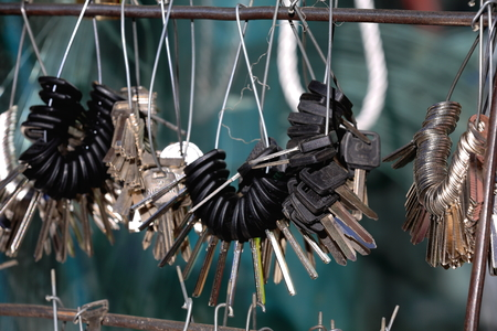 hooked: Hardware workshop with flat blade keys ready to be cut set into bunches hanging from wires hooked on bars in a store of the 3840 ms.high Shigatse city-county and prefecture at the Yarlung Tsangpo and Nyang Chu rivers confluence. Tibet-China.