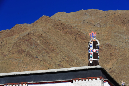 orison: Fabric covered dhvaja-victory banner one of the ashtamangala-auspicious symbols on the roof of the Tashilhunpo-Heap of Glory buddhist monastery seat of Panchen Lama. Shigatse city-county and pref.at the Yarlung Tsangpo and Nyang Chu river junction. Tibet-
