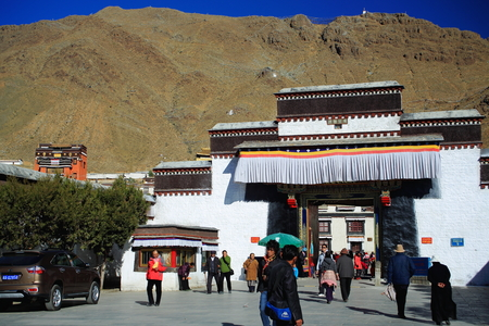 orison: SHIGATSE, TIBET, CHINA-OCTOBER 23: Tibetan devotees pass through the gateway entering and leaving the 1447 AD founded Tashilhunpo-Heap of Glory buddhist monastery-seat of Panchen Lama on October 23, 2012 in Shigatse city-county and pref.at the Yarlung Tsa Editorial