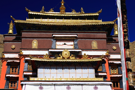 orison: Gilded lotus flowers-dhavajas or victory banners-dharmachakra or law wheel-makaras-garudas-deers: ashtamangala symbols. Roof of Tashilhunpo-Heap of Glory monastery-seat of Panchen Lama. Shigatse-Tibet