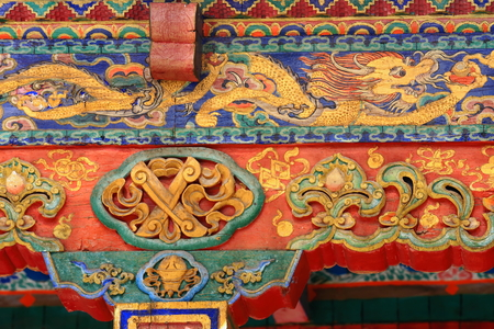 Profusely decorated-carved-painted wooden beams with makaras in the Tashilhunpo-Heap of Glory monastery-seat of Panchen Lama. Shigatse at the Yarlung Tsangpo and Nyang Chu rivers junction-Tibet. Stock Photo