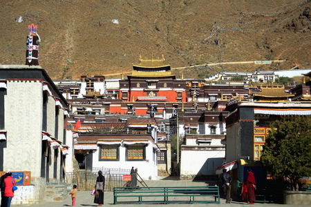SHIGATSE, TIBET, CHINA-OCTOBER 23: Tibetan devotees visit the 1447 AD founded Tashilhunpo-Heap of Glory buddhist monastery-seat of Panchen Lama on October 23, 2012 in Shigatse city-county and pref.at the Yarlung Tsangpo and Nyang Chu rivers junction. Tibe