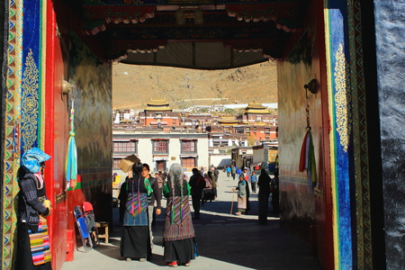 orison: SHIGATSE, TIBET, CHINA-OCTOBER 24: Tibetan devotees pass through the doorway entering and leaving the 1447 AD founded Tashilhunpo-Heap of Glory buddhist monastery-seat of Panchen Lama on October 24, 2012 in Shigatse city-county and pref.at the Yarlung Tsa