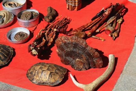 coiled snake: Turtle shell-ginseng-antler-dry snakes. Miscellaneous-curiosity selling stall. Market around Tashilhunpo-Heap of Glory monast.-seat of Panchen Lama. Shigatse-Yarlung Tsangpo and Nyang Chu rivers-Tibet