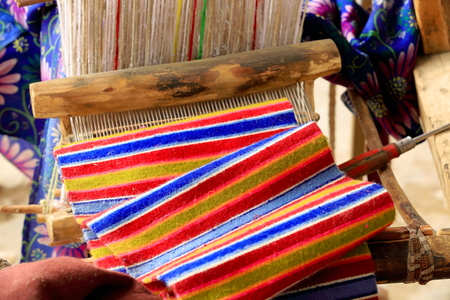 handloom: Traditional old wooden handloom ready for weaving in the courtyard of a homestead in a hamlet of the outskirts of Shigatse city-county and pref. Tibet.