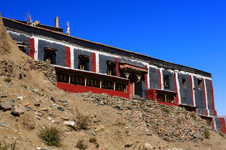 downstream: Building with the grey-red-white colors of the Sakya-Grey Soil buddhist sect in a closed monastery over the Chong Chu-river downstream from Sakya town. Sakya county-Shigatse prefecture-Tibet.