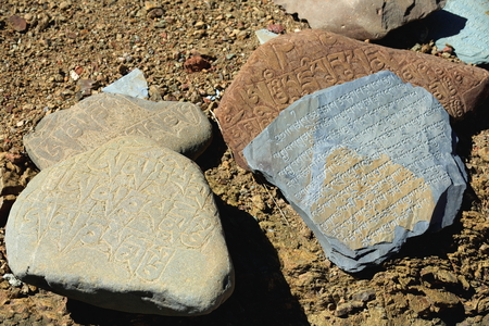downstream: Mani stones with buddhist inscriptions on the grounds of a closed monastery placed over the Chong Chu-river downstream from Sakya-Grey Soil town. Sakya county-Shigatse prefecture-Tibet.