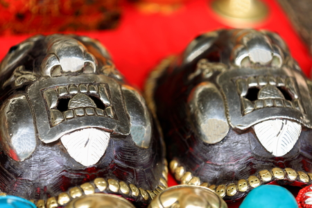 embedded: Traditional tibetan metallic masks embedded in turtle shells for sale in the market of Shigatse city-county and prefecture. Tibet A.R.-China.