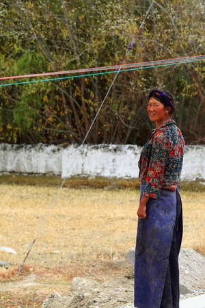 homesteads: SHIGATSE, TIBET, CHINA-OCTOBER 24: Tibetan young mother calls her son playing at their homesteads yard to go back home on October 24, 2012-hamlet near Shigatse city-county and pref.-Tibet.