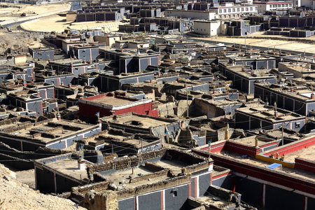 architectonics: Red-grey-white painted city buildings on the grounds of the ancient North Seat of the monastery. Right and left banks of Chong Chu-river at the foot of Ponpori hill-Sakya-Shigatse pref.-Tibet.