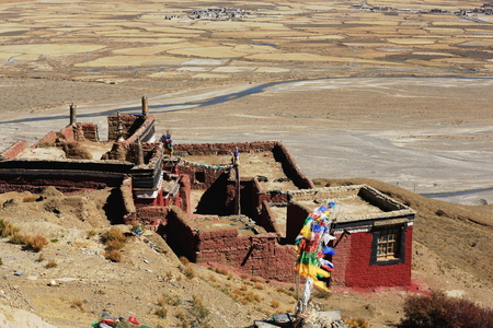 downstream: Closed buddhist monastery-prayer flags in the Chong Chu-river valley overlooking several peasant hamlets set on the right bank downstream from Sakya-Grey Soil town. Sakya county-Shigatse pref.-Tibet.