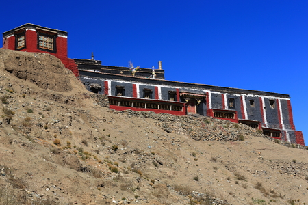 downstream: Building with the grey-red-white colors of Sakya-Grey Soil buddhist sect on grounds of closed monastery over the Chong Chu-river valley downstream from Sakya town. Sakya county-Shigatse pref.-Tibet. Stock Photo