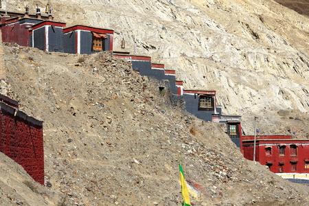 architectonics: Grey-red-white painted temple of the 1073 AD-Khon Konchog Gyalpo founded North Seat of Sakya-Grey Soil monastery on the slope of Ponpori Hill-right bank of Chong Chu-river. Sakya-Shigatse pref.-Tibet. Stock Photo