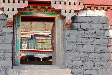 spall: Painted wooden door frame and lintel. Nunnery on Ponpori Hill-grounds of the 1073 AD-Khon Konchog Gyalpo founded N.Seat of Sakya-Grey Soil monastery. Right bank of Trum or Chong Chu river-Sakya-Tibet.