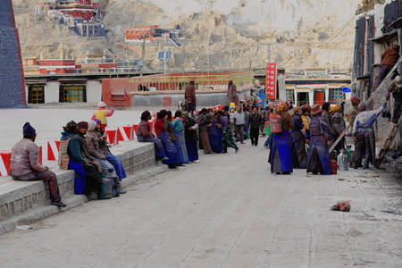community service: SAKYA, TIBET, CHINA-OCTOBER 25: Local people get ready for community service: the painting of the walls facing the Sakya-Grey Soil monasterys South Seat on October 25, 2012. Sakya-Tibet. Editorial