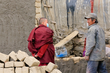 community service: SAKYA, TIBET, CHINA-OCTOBER 25: Monks and locals get ready for community service: the painting of the walls facing the Sakya-Grey Soil monasterys South Seat on October 25, 2012. Sakya-Tibet. Editorial