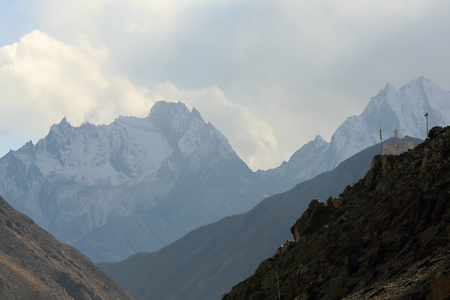 cloud capped: Jagged peaks-Jugal Himal section of Himalayas over Matsang Tsangpo-Sun Kosi river valley in Nyalam county. Nyalam town at 3750 ms.-Friendship Highway down Tong La pass at 5120 ms. Shigatse pref.-Tibet