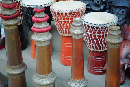 music therapy: Traditional tibetan-nepalese taal drumsgya ling or tibetan trumpets or indian trumpetswooden masks. Souvenir shop in the Thamel area of Kathmandu city. Kathmandu district-Bagmati zone-Nepal.