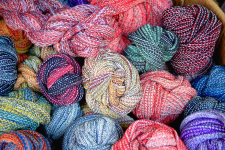 slew: Heap of manycolored yak wool skeins piled in a box for sale in a souvenir shop in the Thamel area of Kathmandu city. Kathmandu district-Bagmati zone-Nepal.