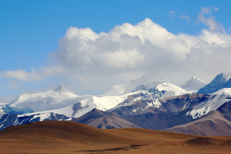 tableland: View of the Lapche or Labuche Himal section of the Himalayas with mount Lapche Kang II at 7250 ms.in the center-right. From Tong La-pass at 5120 ms.on Friendship Highway between Tingri and Nyalam-Tibet.