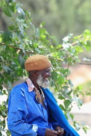 amharic: DEBRE BIRHAN, ETHIOPIA-MARCH 24: Blue dressed old man sits on the Baresa river bridge-waits grandson to come back from school on March 24, 2013. Debre Birhan tow-S.N.Shewa zone-Amhara region-Ethiopia. Editorial