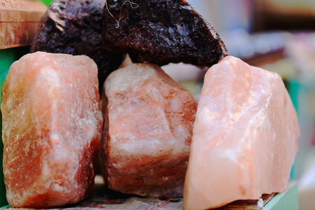 slew: Nepalese pink quartz stones set for sale in the windowshop of a souvenirs and minerals selling shop in the Thamel area of Kathmandu city. Kathmandu district-Bagmati zone-Nepal.
