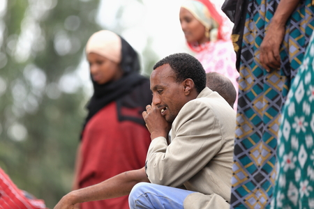 sunday market: SENBETE, ETHIOPIA-MARCH 24, 2013: Afar man talks on the phone while attending the sunday market where the oromo-amhara-afar peoples meet on March 24, 2013. Senbete-Oromia zone-Amhara region-Ethiopia. Editorial