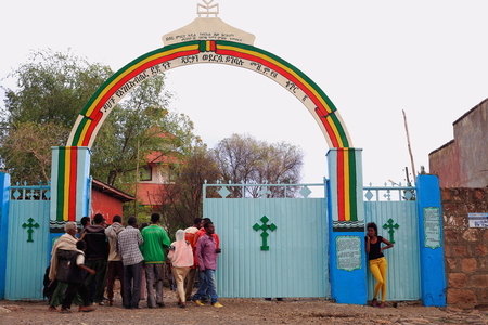 religious service: KOMBOLCHA, ETHIOPIA-MARCH 24: Group of devotees enters the church compound to attend religious service in Bete Gebriel-Saint Gabriel christian church on March 24, 2013. Debub Wollo zone-Amhara region.