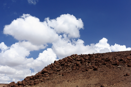 barren land: Cumulus clouds over volcanic stones on the Awash river valley seen from the Awash-Asseb Highway between Mile and Semera towns. Administrative zone 1-Afar region-Ethiopia.