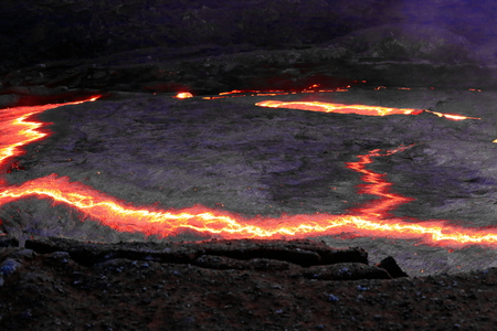 World longest existing burning lava lake dating from 1906 in the Erta Ale-Smoking Mountain basaltic shield volcano at 613 ms.high-eliptic crater of 0.7 x 1.6 km. Danakil desert-Afar region-Ethiopia. Stock Photo