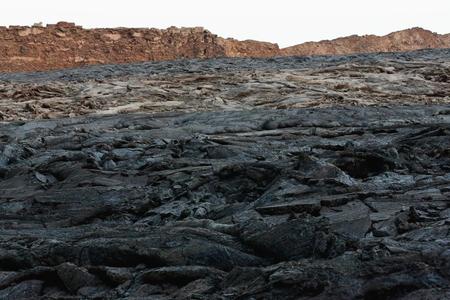 badland: Solid lava field-caldera of world longest existing burning lava lake dating from 1906-Erta Ale basaltic shield volcano at 613 ms.high-0.7 x 1.6 km.eliptic crater. Danakil desert-Afar region-Ethiopia.