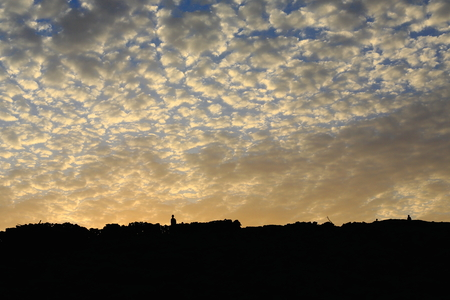 resplendence: Mackerel sky of altocumulus clouds over the eliptic crater of Erta Ale-Smoking Mountain volcano of 0.7 x 1.6 kms.and 613 ms.high. Danakil desert-Afar region-Ethiopia.